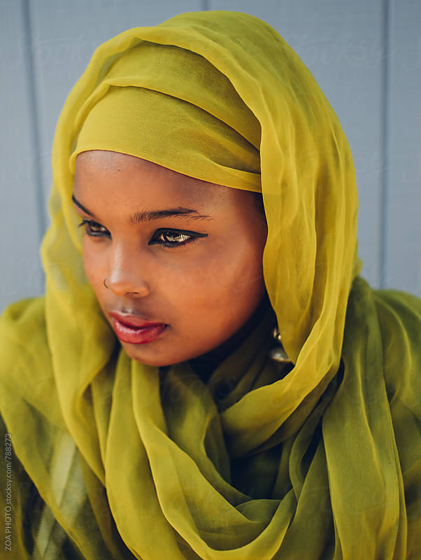 Stoic looking Somali-American muslim woman with hijab by ZOA PHOTO for Stocksy United