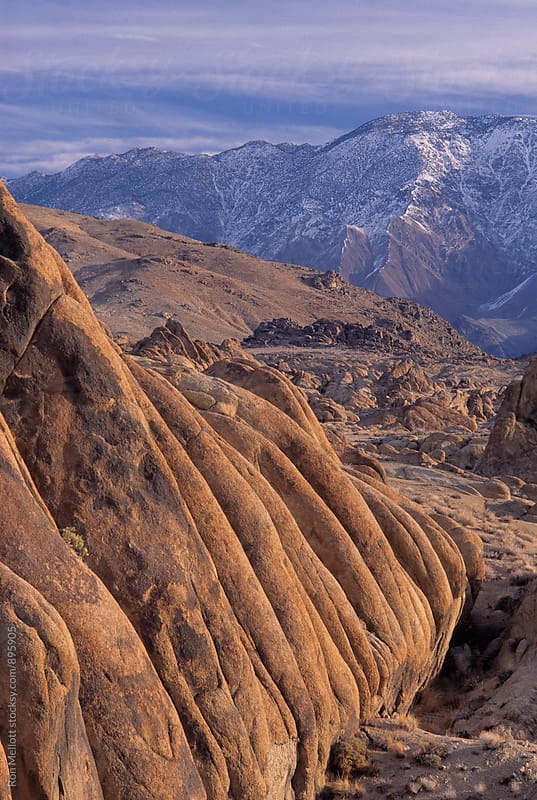 35-mm film image afternoon winter light on Alabama Hills and Inyo Mountains, California by Ron Mellott for Stocksy United