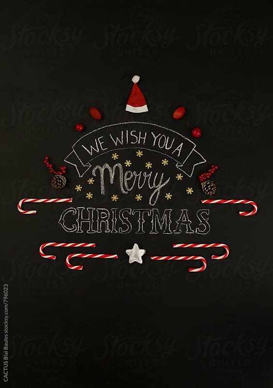 Christmas card on a chalkboard by Blai Baules for Stocksy United