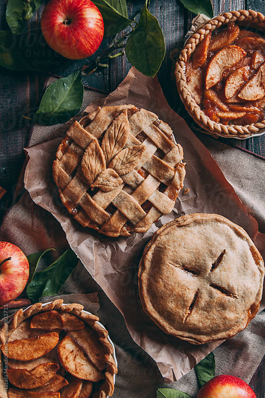 Apple pies with different decorations by Nataša Mandić for Stocksy United