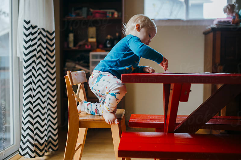 Side View of Toddler Boy Coloring at the Kitchen Table by Amanda Voelker for Stocksy United