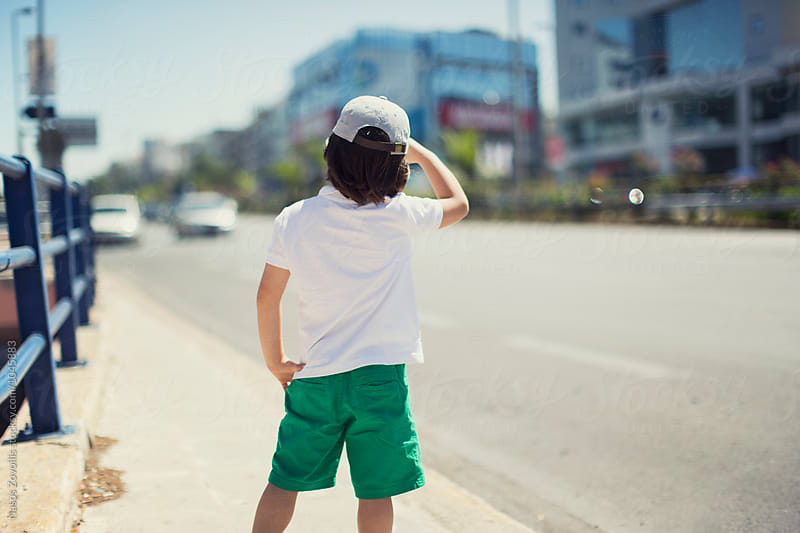 5 year old looking ahead at the street by Nasos Zovoilis for Stocksy United