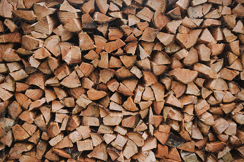 Chopped logs for firewood by Suzi Marshall for Stocksy United
