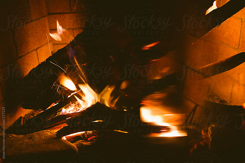 Cozy by the fire by Jesse Morrow for Stocksy United