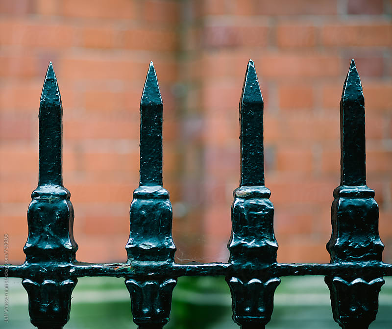Wrough Iron Fence Spikes by Jeff Wasserman for Stocksy United
