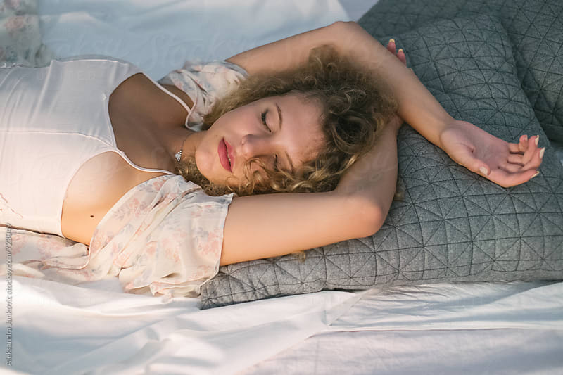 Sensual Blond Woman Sleeping in Bed by Aleksandra Jankovic for Stocksy United