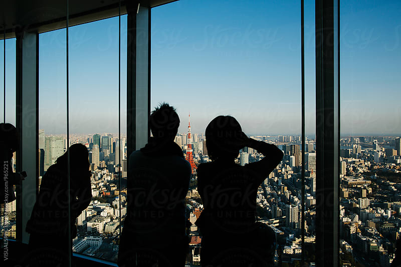 Silhouette of Tourists Looking at Tokyo Cityscape from Skyscraper Viewpoint by VISUALSPECTRUM for Stocksy United