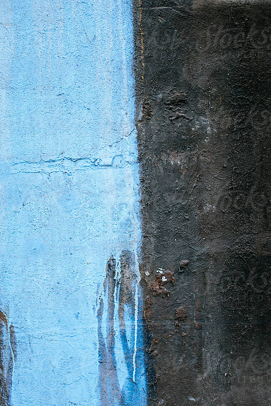 Blue paint dripping down wall of old and weathered building exterior by Paul Edmondson for Stocksy United