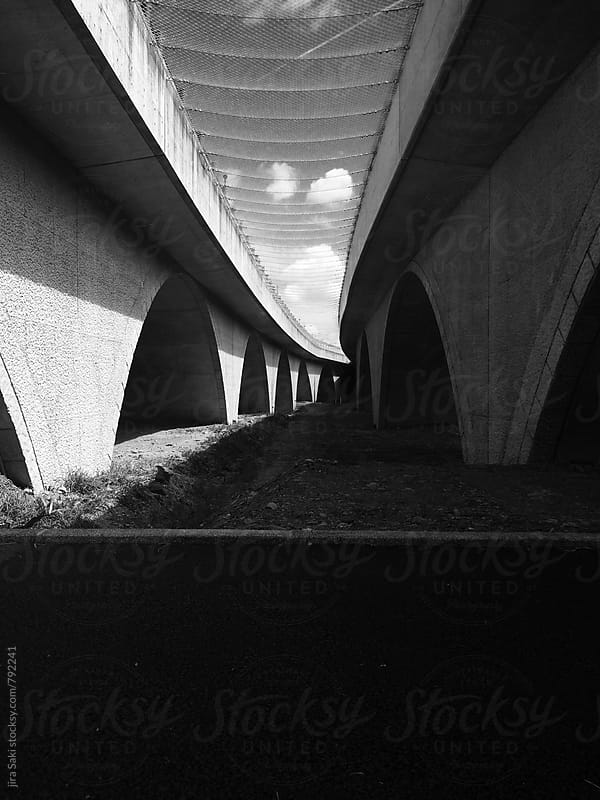 under the arch bridge view by jira Saki for Stocksy United