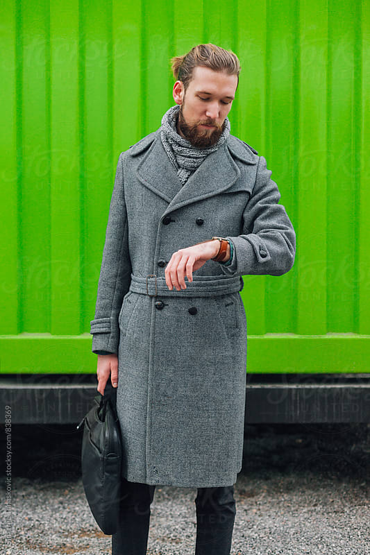 Stylish man in front of the green background by Dimitrije Tanaskovic for Stocksy United