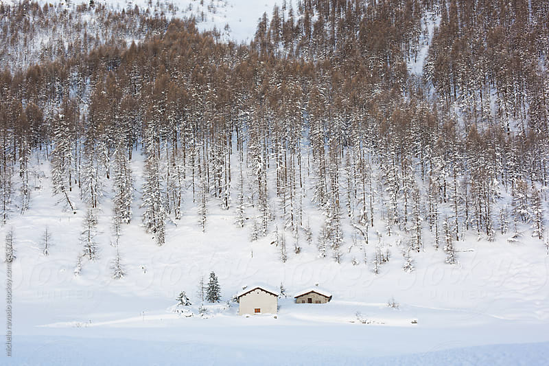 Two houses submerged by snow in the mountains by michela ravasio for Stocksy United