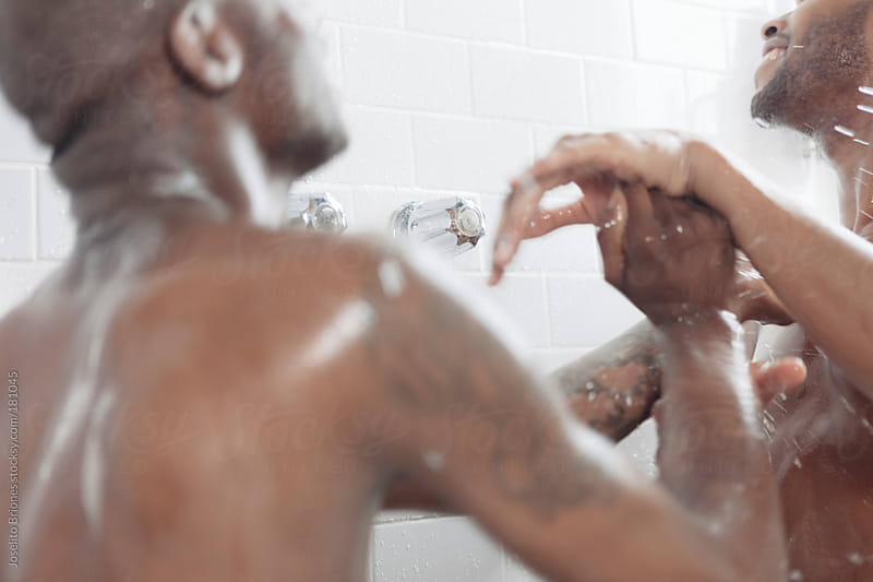 Gay Black Men Couple Having Fun Taking Shower Together by Joselito Briones for Stocksy United