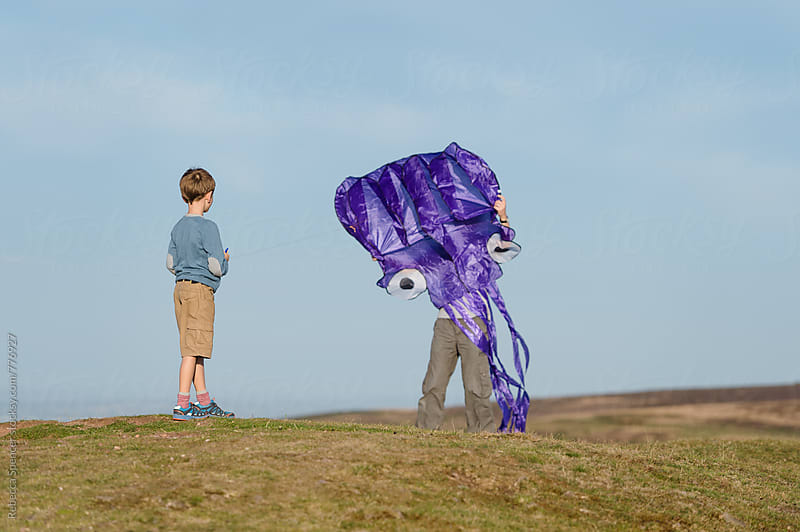 Man hidden behind a huge kite by Rebecca Spencer for Stocksy United