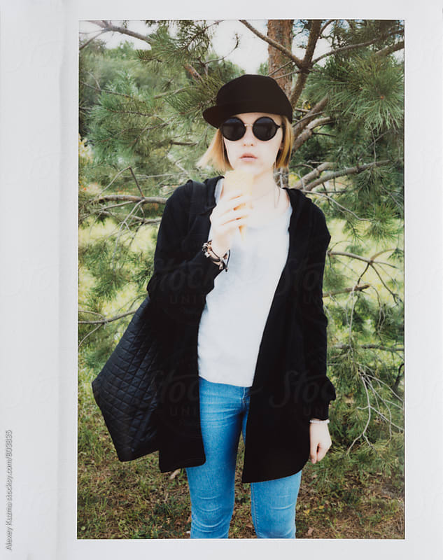 teen girl with ice-cream  by Alexey Kuzma for Stocksy United