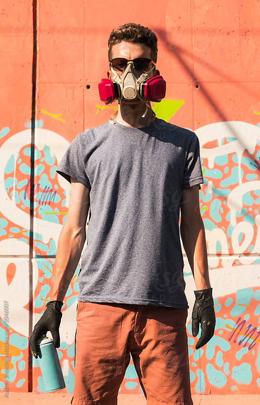 Portrait of street artist in front of his work/mural. by Audrey Shtecinjo for Stocksy United