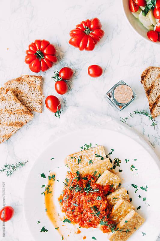 Tempeh with vegan sauce by Nataša Mandić for Stocksy United