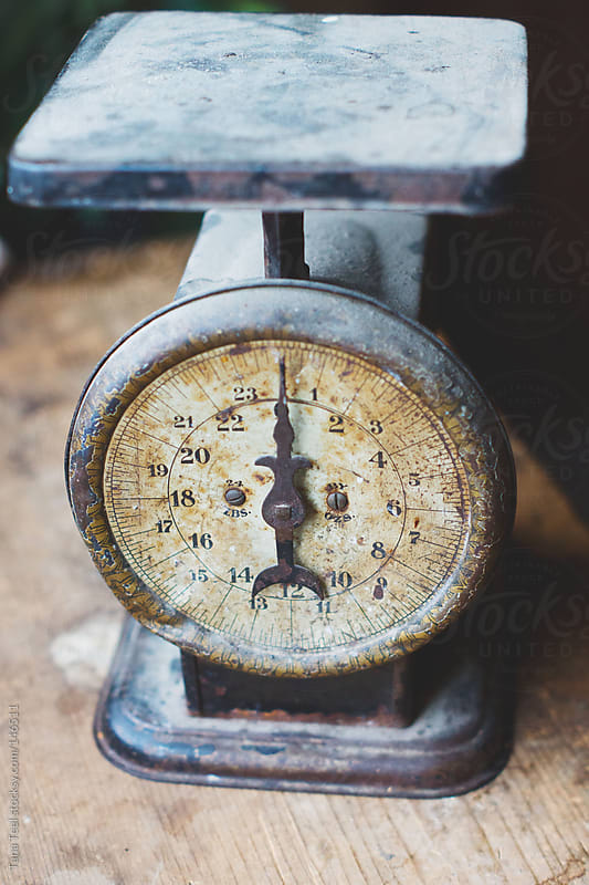 An old scale sits on a counter by Tana Teel for Stocksy United