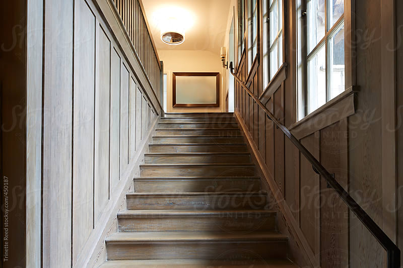 Wood staircase in luxury home by Trinette Reed for Stocksy United