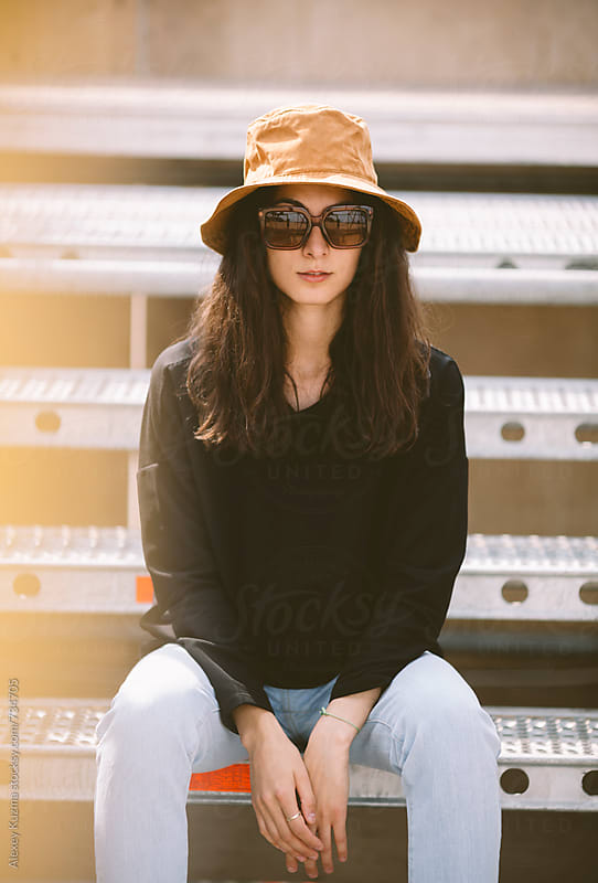 portrait of real young woman with hat and sunglasses. by Alexey Kuzma for Stocksy United