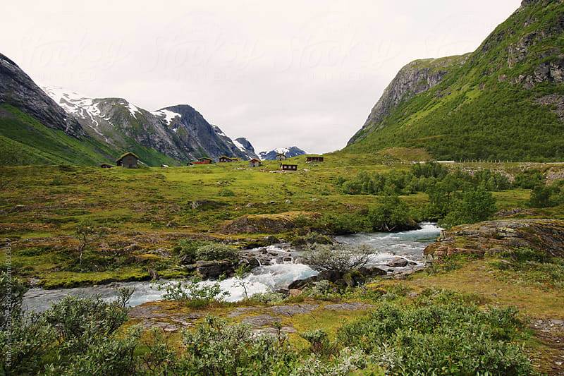 Norwegian landscape with hytter (cottages) in the background by Kaat Zoetekouw for Stocksy United