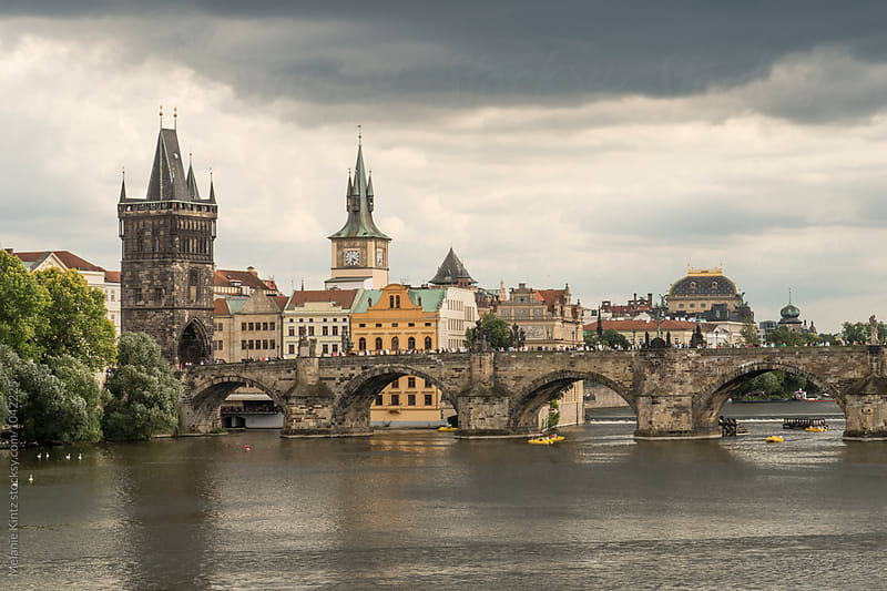 Prague under Thunderclouds, view towards Charles Bridge by Melanie Kintz for Stocksy United