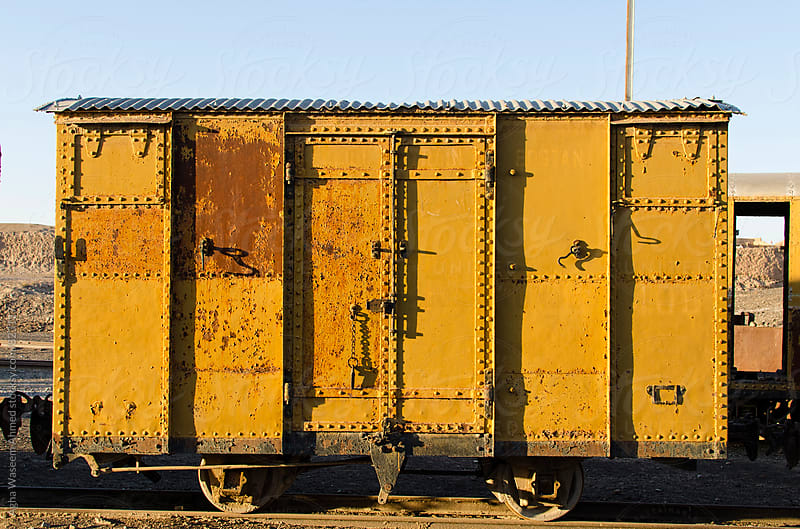 An old and obsolete narrow gauge yellow coloured Railroad boggy ! by Agha Waseem Ahmed for Stocksy United