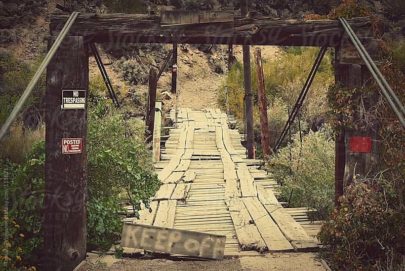 Old Bridge With Old Signs by Tamara Pruessner for Stocksy United