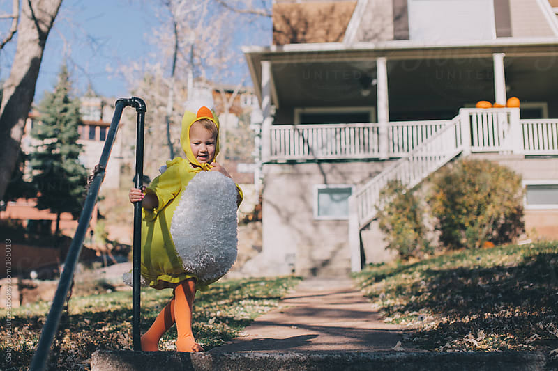 Little Kid in Chick Costume by Gabrielle Lutze for Stocksy United