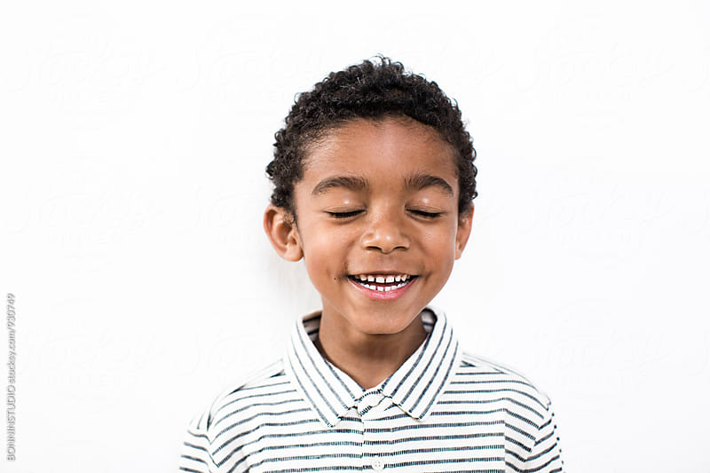 Portrait of a happy little boy over white background. by BONNINSTUDIO for Stocksy United