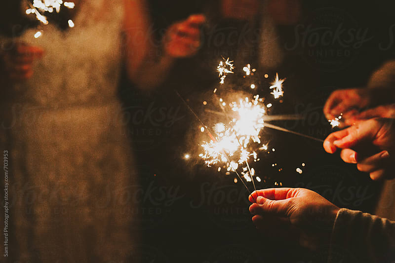 sparklers in hand by Sam Hurd Photography for Stocksy United