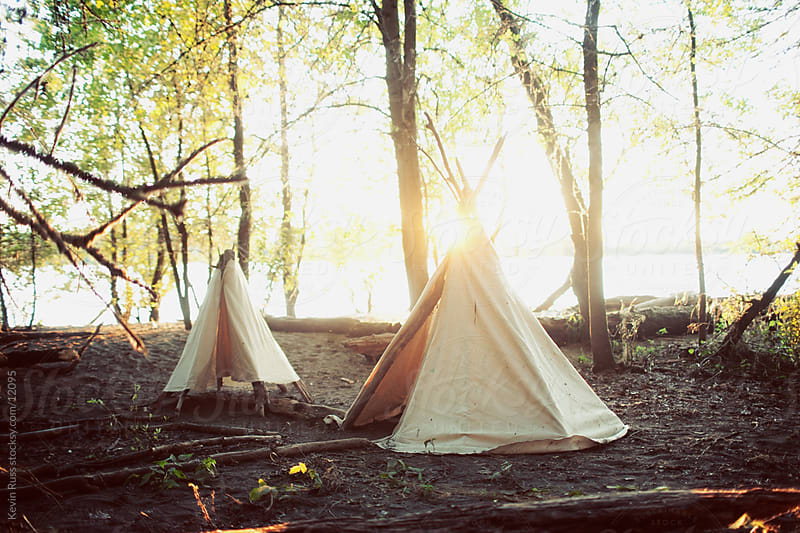 River Woods Teepees by Kevin Russ for Stocksy United
