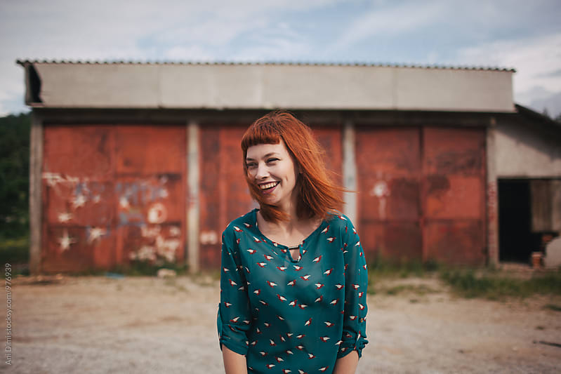 Red head girl smiling  by Ani Dimi for Stocksy United