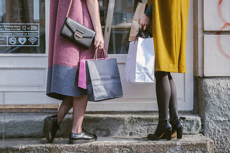 Close up of a Two Women with Shopping Bags Standing in Front of the Shop Window by Aleksandra Jankovic for Stocksy United