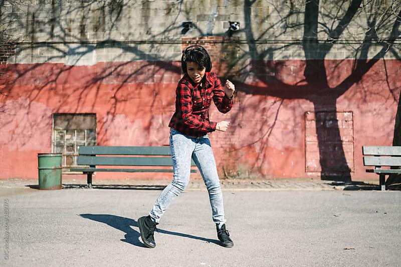 Young woman during krump break dance in Williamsburg, Brooklyn by GIC for Stocksy United