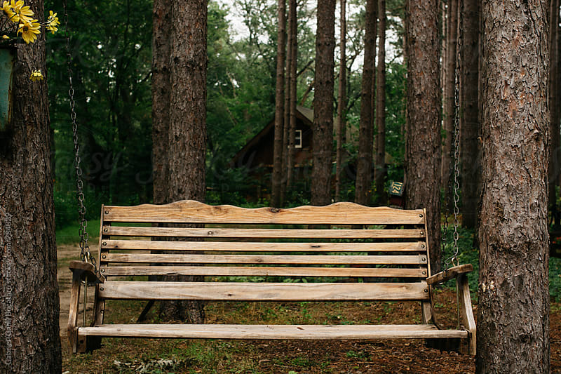 Wooden swing by a log cabin by Gabriel (Gabi) Bucataru for Stocksy United