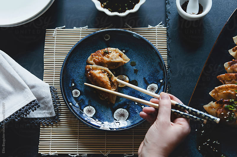 Fried pot stickers by Ellie Baygulov for Stocksy United