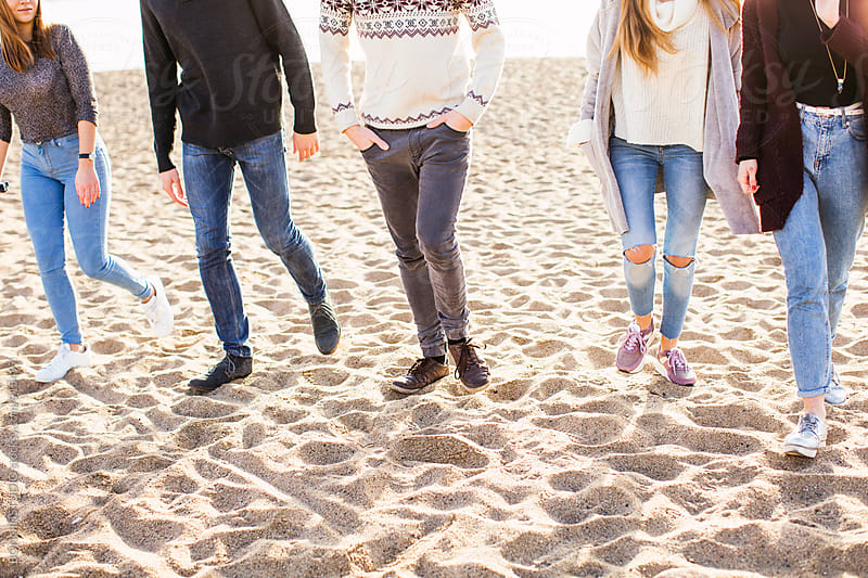 Closeup of teen friends walking on the beach. by BONNINSTUDIO for Stocksy United