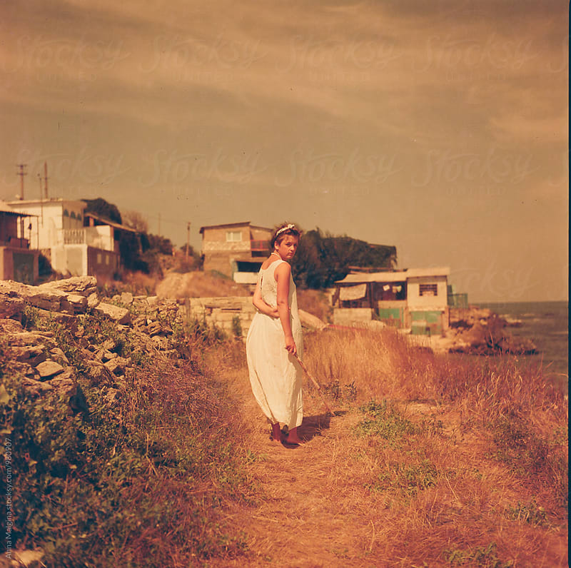 A film photo of a young beautiful woman nearby the sea by Anna Malgina for Stocksy United
