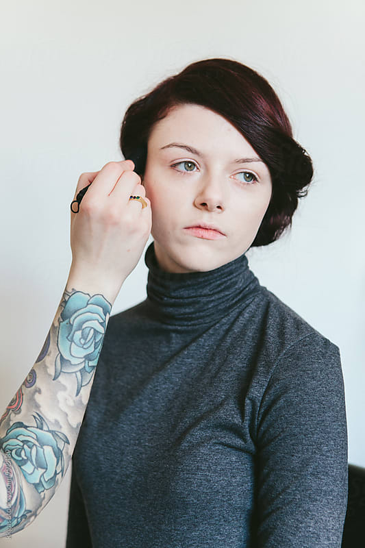 Beautiful woman in her twenties having make up applied by kkgas for Stocksy United