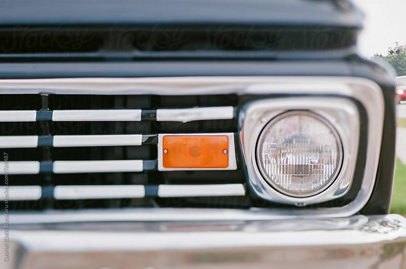 Headlight of an old car by Gabriel (Gabi) Bucataru for Stocksy United