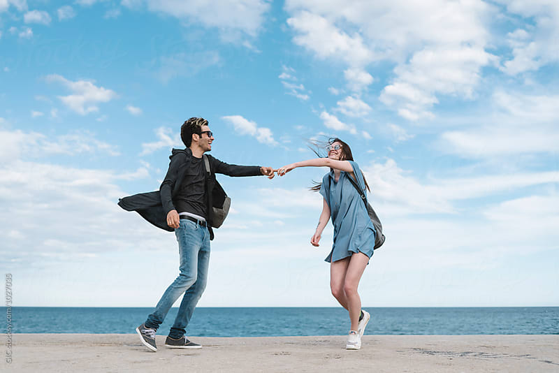 Couple dancing against the sea by GIC for Stocksy United
