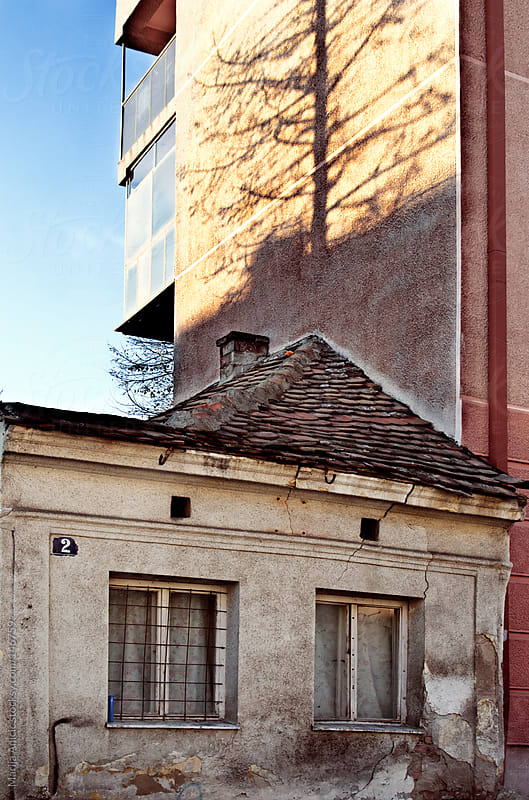 Little old house near the new building by Marija Anicic for Stocksy United