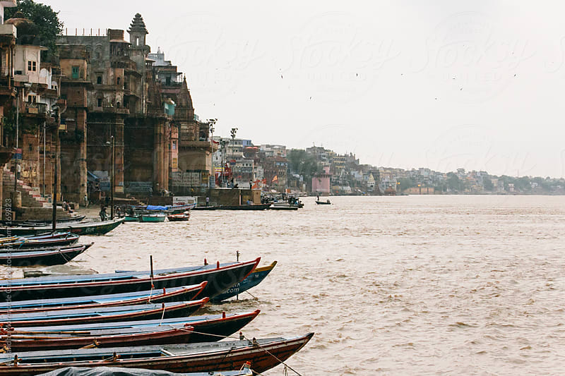 Boats and temples in Ganges River, Varanasi, India by Alejandro Moreno de Carlos for Stocksy United