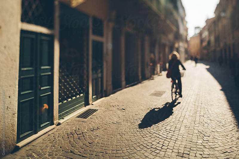 Cycling at sunset by Good Vibrations Images for Stocksy United