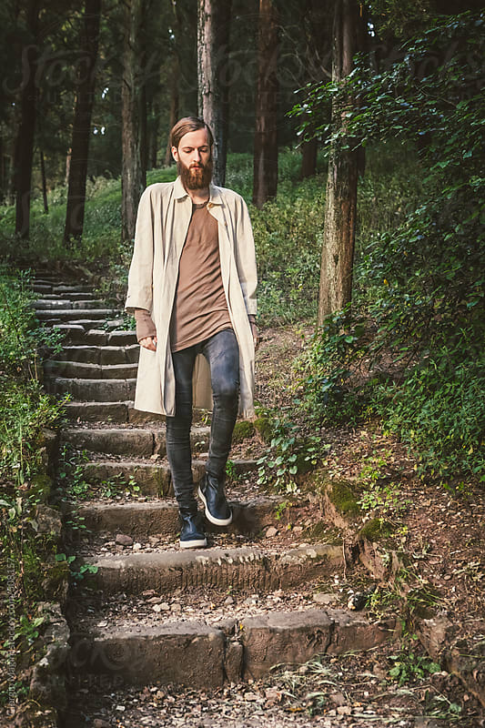 Bearded Young Man with Dark Fashion Clothes in the Woods by Giorgio Magini for Stocksy United