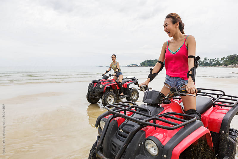 Two girls driving an ATV