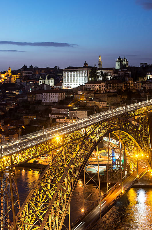 Views of the old town of Oporto at dusk by Bisual Studio for Stocksy United