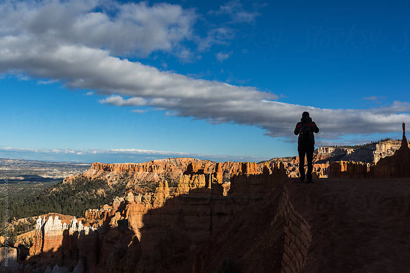 Man photographs the Bryce Canyon Amphitheater by michela ravasio for Stocksy United