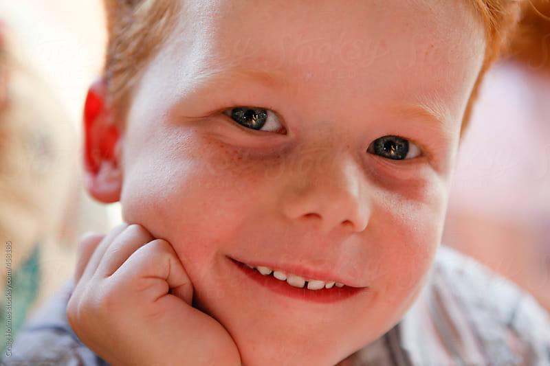 Portrait of a six year old boy by Craig Holmes for Stocksy United
