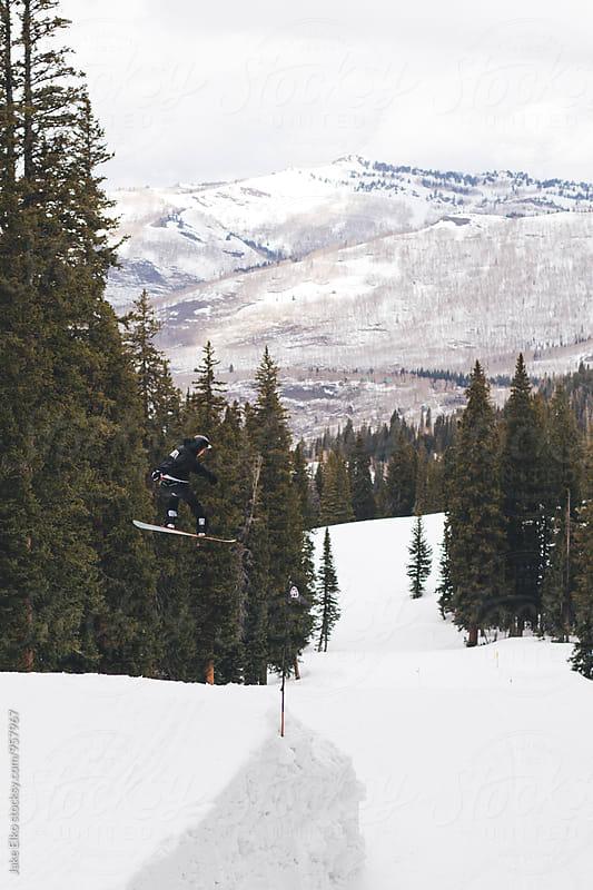 Snowboarding Off Jump by Jake Elko for Stocksy United